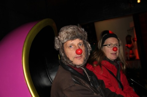 It is one persons job to give out clown noses for this ride all day long