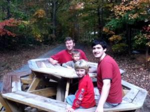Ez, Zadek, Sami and Arlo at hexagonal table