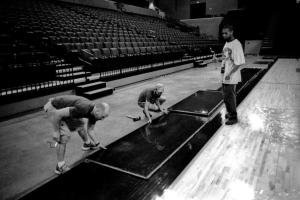 Jason (middle), Tony and Elijah install the floor at the JPJ arena, cville.