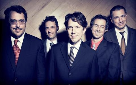 This band does not wear ties often - and has not had a line up change in 10 years.