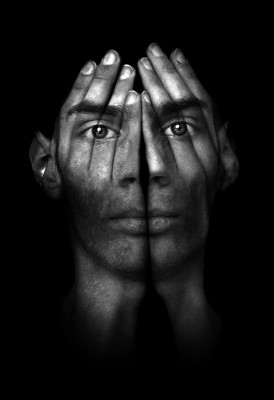 surreal-man-with-hands-covering-face