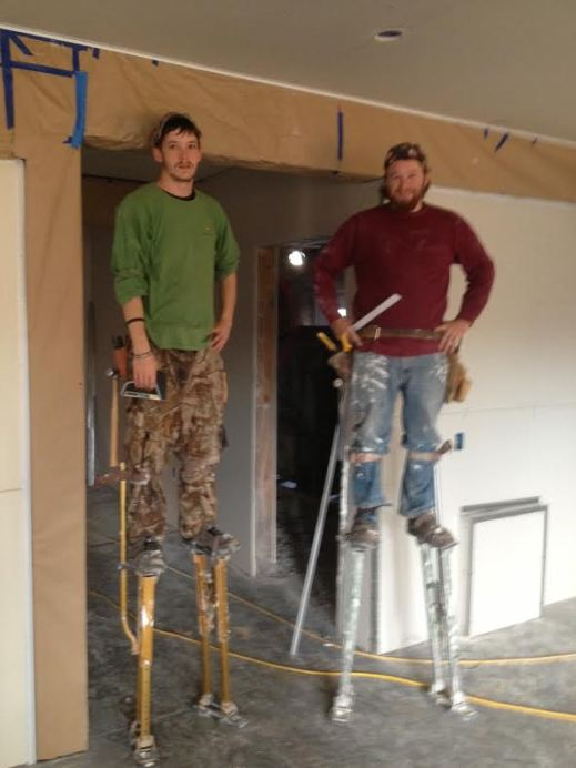 Drywall guys pause briefly for picture