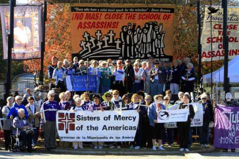 Sisters of Americas at SOA with banner