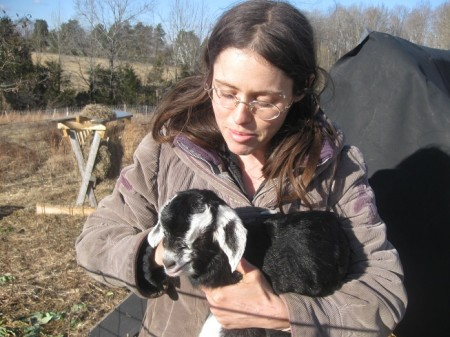 Rejoice is pictured here with a baby goat named Sweet Chocolate.