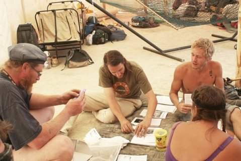 Lex at the ill fated Villages in the Sky BM camp in 2009.  Folding fingerbooks next to me.