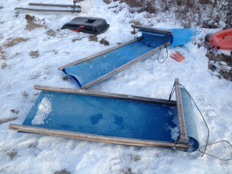 Sleds made from 55 gallon plastic barrels and second spreader bars