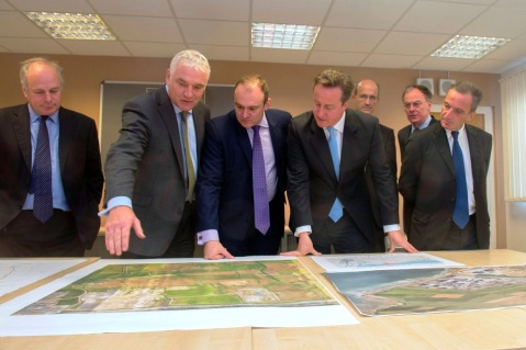 UK PM David Cameron in photo op with Areva thieves.