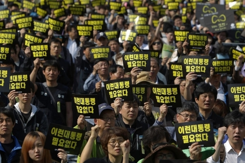 "May Day 2014 - South Korea.  The signs sat ""We deserve a better president"""