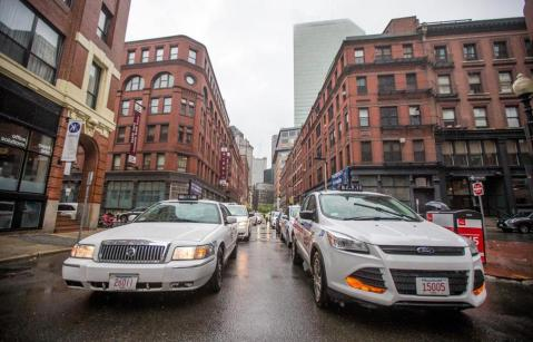 Taxis protest and road block the Uber headquarters