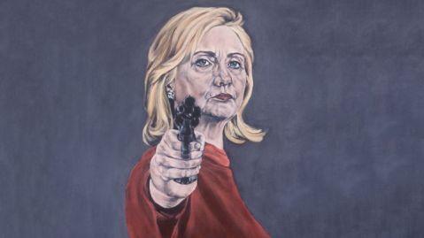 hillary with a gun