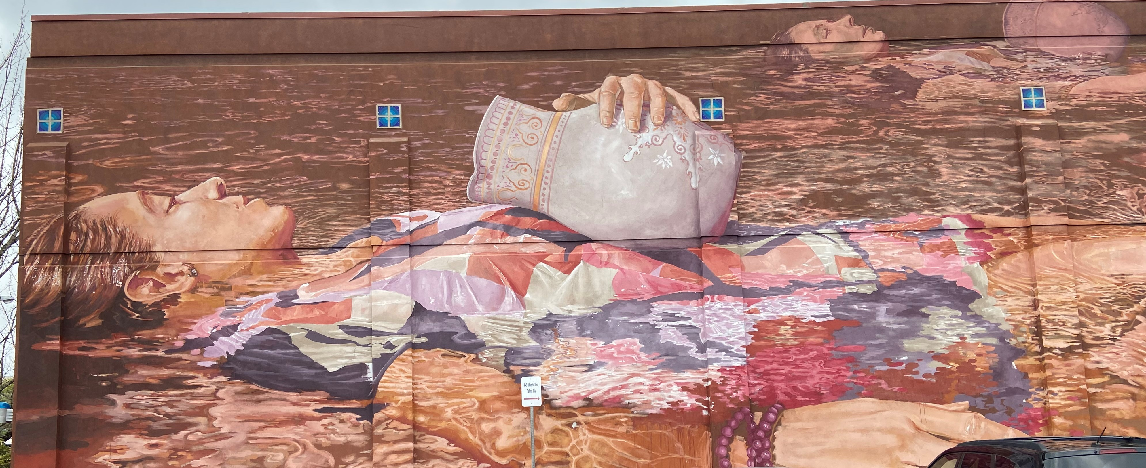 laying lady mural